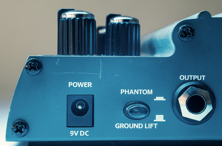 phantom: Details of a guitar pedal, part with power, phantom and output ports.