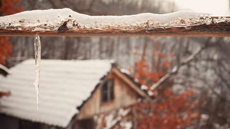 back gate: Details of a wooden gate during winter season, old retro house in the back.