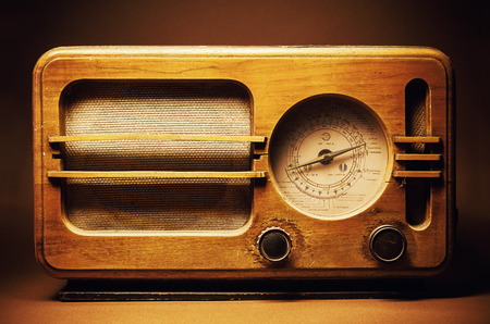 Radio: Design of an old wooden radio device. Names of European towns written in Cyrillic as radio stations. Balkan retro style from first half of 20th century.