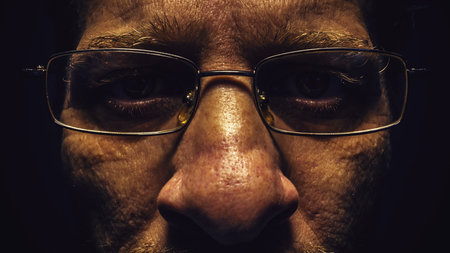 dramatic characters: Portrait of a middle age man, details of eyes and glasses.