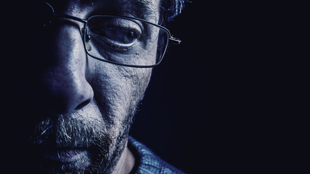 dramatic characters: Portrait of a middle age man wearing glasses and beard. Stock Photo
