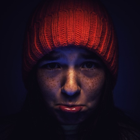 dramatic characters: Portrait of a young girl with face expression of unhappy feelings.