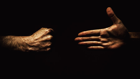 Conceptual composition about reconciliation or hate.