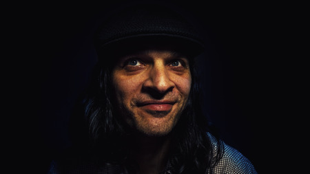 cool dude: Cool dude in good mood, portrait of a man with hat, smiling and looking aside.