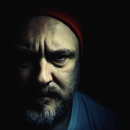 expresion corporal: Hombre de mediana edad, con un sombrero y la barba con bigote. Foto de archivo