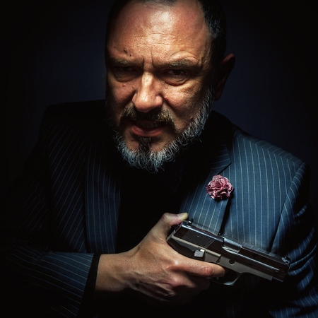 mister: Mister with silver gun, portrait of a middle age man.