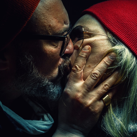 loved: Portrait of a man and woman, deeply loved and hugged.