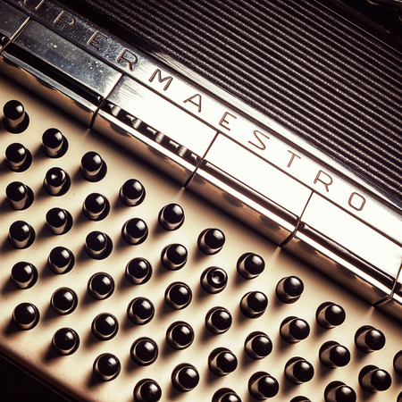 octaves: Details of an old accordion, closeup view.