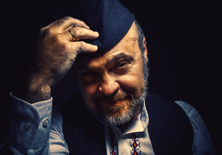 unique characteristics: Portrait of a middle aged man wearing an old fashioned clothes from Serbia. Stock Photo