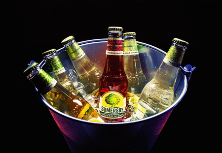 specialty: Cacak, Serbia - March 30, 2016: Six bottles of Somersby drink in bucket, served for group of people. Editorial