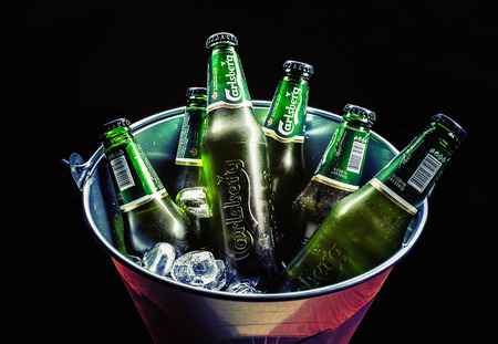Cacak, Serbia - March 30, 2016: Six bottles of Carlsberg beer in bucket, served for group of people.