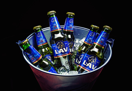 Cacak, Serbia - March 30, 2016: Six bottles of Lav beer in bucket, served for group of people.