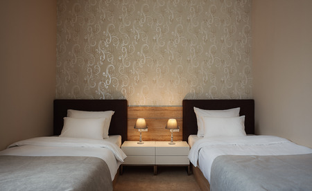ambience: Modern interior of a hotel room for two, calm ambience with retro lamps and comfortable furniture.