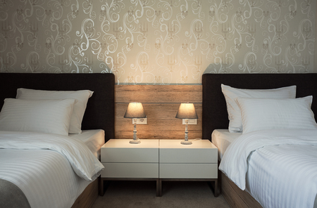 Modern interior of a hotel room for two, calm ambience with retro lamps and comfortable furniture.