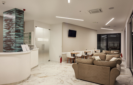Interior of a modern hotel, reception place. Banco de Imagens