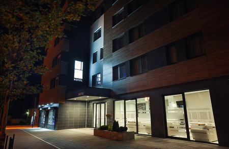 apartment building: Exterior of a modern hotel during night, view to entrance. Stock Photo