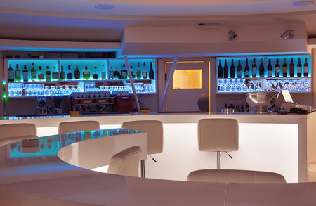 white interior: Interior of a modern cafe bar, white futuristic furniture with interesting lighting.