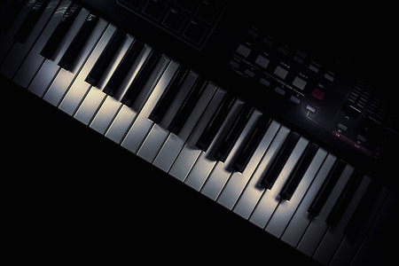 octaves: Details of a keyboard, accentuated keys with illumination. Stock Photo