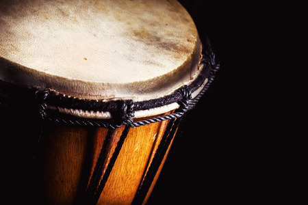 percussion: Closeup view of wooden djembe, accentuated shapes.