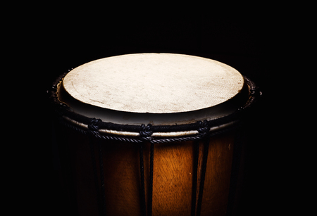 african drums: Closeup view of wooden djembe, accentuated shapes.