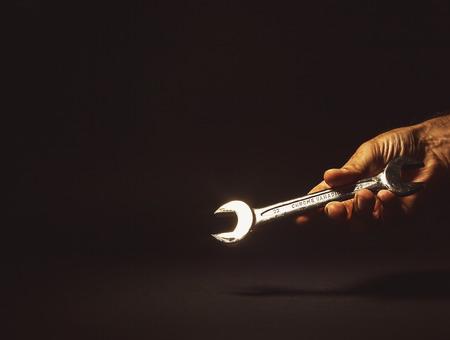 chrome vanadium: Conceptual composition, mans hand holding a key tool, number 22, made of chrome vanadium.