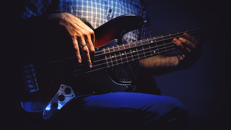 bass player: Bass player and his guitar, expressions while playing.