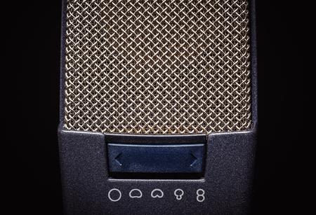 cardioid: Details of two studio microphones, on black background. Foto de archivo