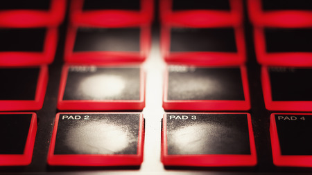 midi: Part of a modern used midi controller, view on pads for finger drumming.