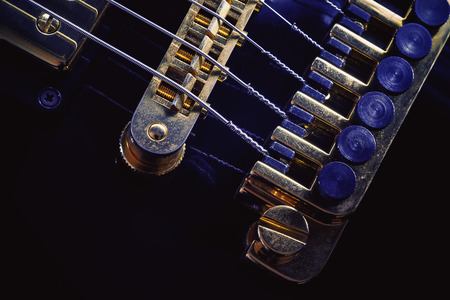 octaves: Part of an electric guitar, closeup view on bridge and fine tuners. Stock Photo