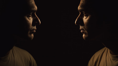 straight man: Portraits of a same man, looking each other straight in the eyes.