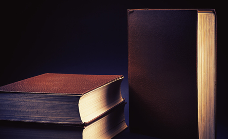 leatherette: Three old book on blue background.