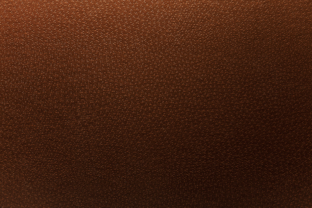 leatherette: Texture of a leatherette brown surface.