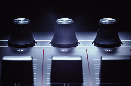 knobs: Details of a modern midi controller, view on sliders and knobs.