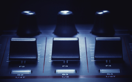 sliders: Details of a modern midi controller, view on sliders and knobs.
