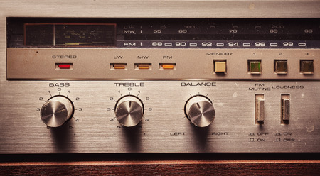 radio unit: Details of an old radio receiver, close up view control knobs and buttons.