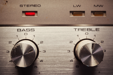 loudness: Details of an old radio receiver, close up view on bass and treble pots.