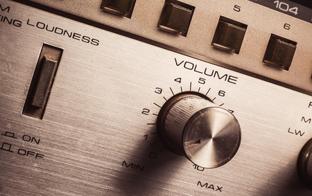 loudness: Details of an old radio receiver, close up view on volume pot and loudness button. Stock Photo