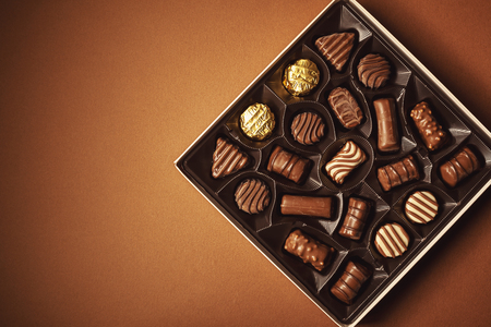 Closeup view of box of chocolates, view from above. Stock Photo