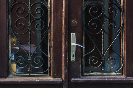 stylistic: Details of an old retro wooden doors with glass. Stock Photo