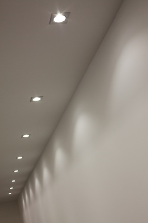 office ceiling: Details of installed modern lights in the ceiling.