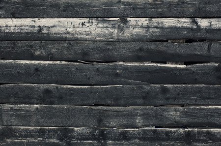 Details of a texture of an old dark wooden wall.