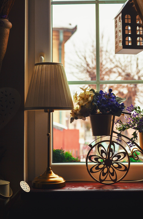 decorative objects: Decorative objects in front of window, indoor details.  Stock Photo