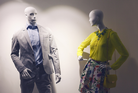 fashion dress: Details of a fashion shop, man and woman dolls dressed and look like pair.