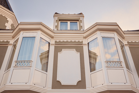 roof windows: Part of a big house or a building, windows of a loft room and roof. Stock Photo