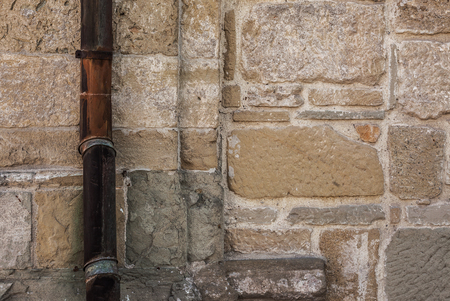 rabbet: Details of an old stone wall, obsolete architectural style and old gutter. Stock Photo