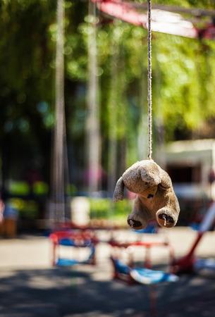 ahorcada: Part of a carousel, little bear toy as reward ride hanged on rope. Foto de archivo