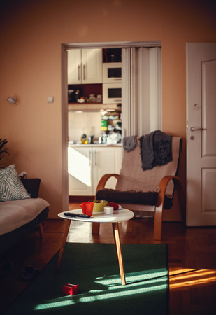 messy clothes: One ordinary home room, interior details during sunny day.