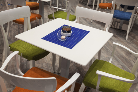 stylistic: Modern and new wooden white set of table and chairs.