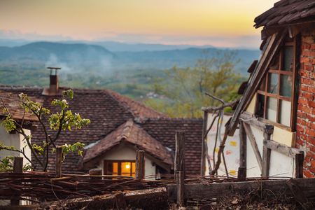 balkans: Wooden houses in sunset, part of Serbian old and traditional household.