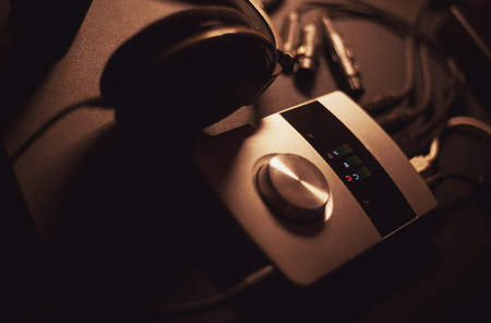 Audio interface and headphones as modern recording system, mobile and small. Stock Photo
